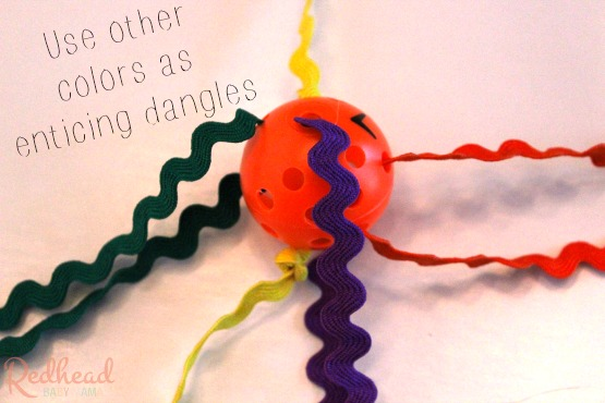 thread lots of colors to create enticing dangles in your cat toy