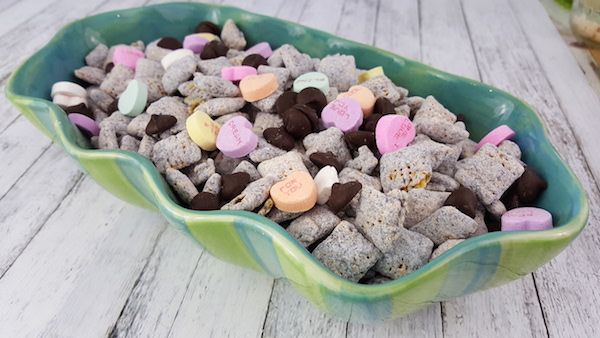 Valentine's Day Muddy Buddies: Mix a traditional Muddy Buddies Recipe together with Valentine's Hearts to create a lovely snack mix!