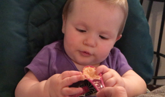 Touching foods and playing with spoons helps teach babies how to handle them!