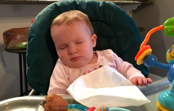 Sleeping Baby in the Highchair