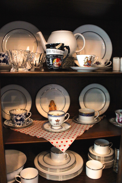 Alice in Wonderland China Cabinet with teacups and surprises