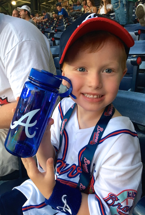 Red's first braves game, complete with swag! Atlanta Braves Kid's Club, #ChopOn