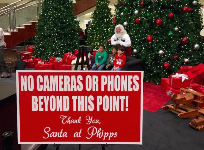 You can still use your own camera,but don't step into Santa's space!