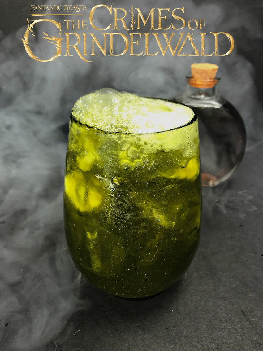 Remember the Crimes of Grindlewald with this shimmering, magical cocktail of green and silver. This Fantastic Beasts Cocktail is Slytherin-made, perhaps?
