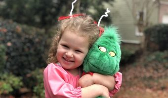 Cindy Lou Who pink dress costume hugging the grinch
