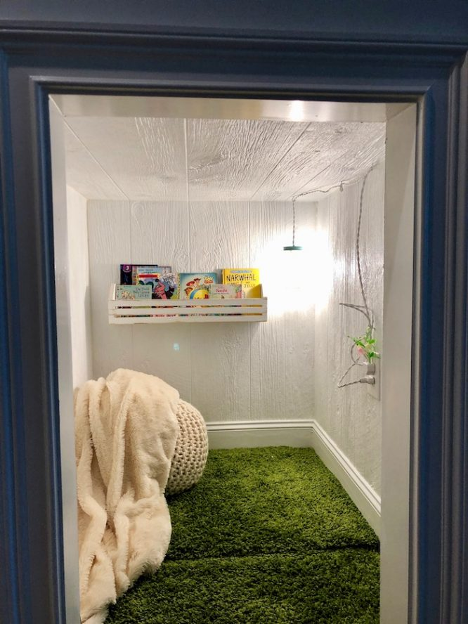 complete white paint reading nook with green shag rug and lamp