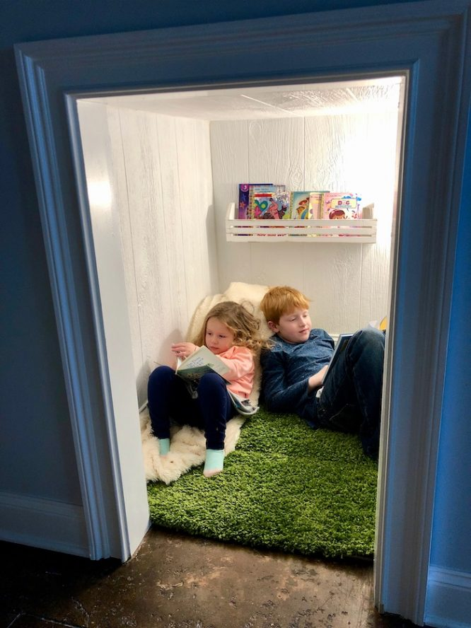 kids reading nook under the stairs