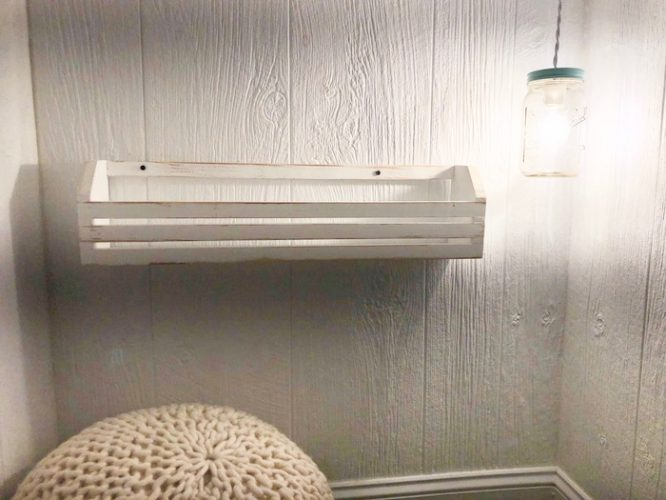white accent shelf and lamp reading nook