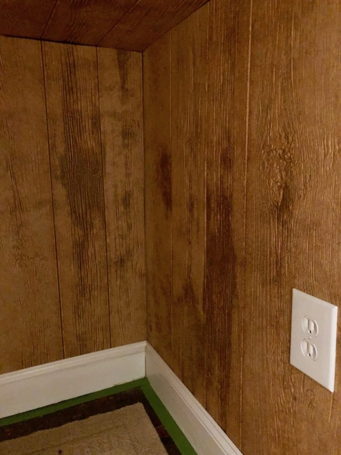 wood paneling under the stairs nook