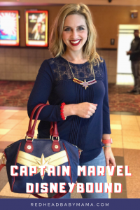 captain marvel disneybound girl with purse and necklace logo accessories