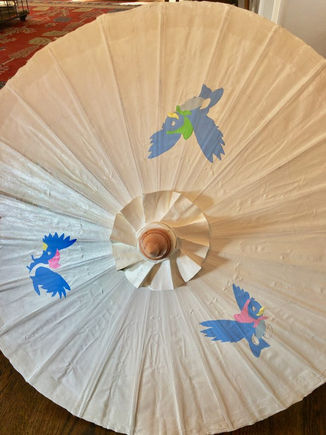 base color your hand painted parasol images in with acrylic paint
