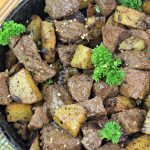 One Pot Wonder Steak and Herbed Potatoes in a Cast iron Skillet