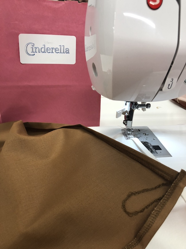 sewing-like-cinderella-fabric-on-sewing-machine