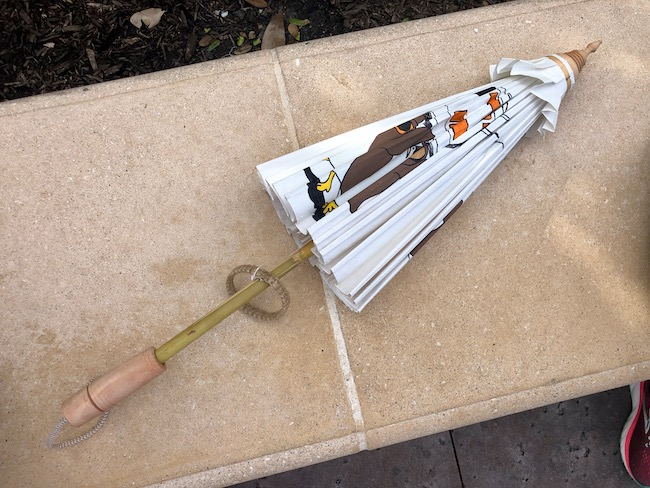 folded parasol with porgs painted on it
