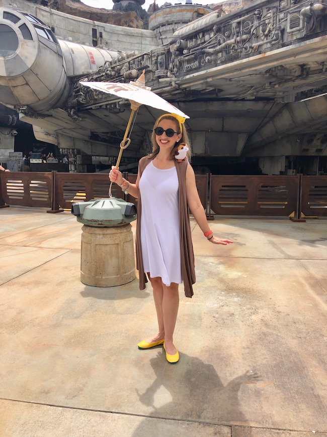 the best porg disneybound. White dress, tan vest and yellow headband and shoes