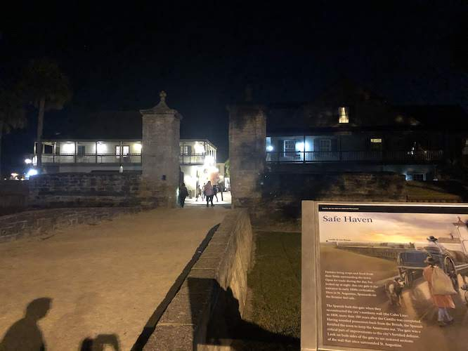 The Safe Haven City Gates at night in St Augustine
