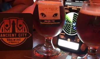 Ancient City Brewing Company coaster and beer goblet sit with a ghost meter