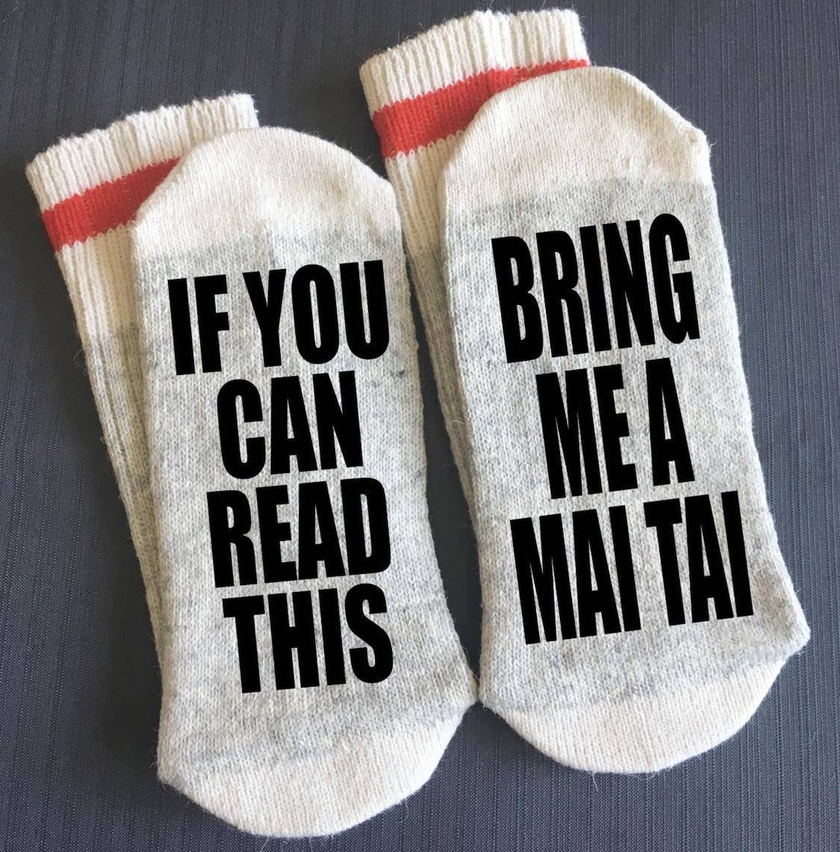 cozy socks that read on the bottom If you can read this, bring me a mai tai